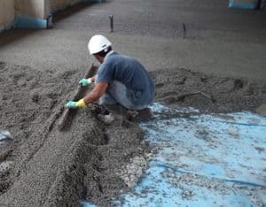 A tradesman levelling grout.